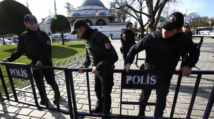 Policemen install security barriers at the historic Sultanahmet district, which is popular with tourists, after an explosion in Istanbul, Tuesday, Jan. 12, 2016. Turkish media reports say several people have been injured in the explosion. (AP Photo/Lefteris Pitarakis)
